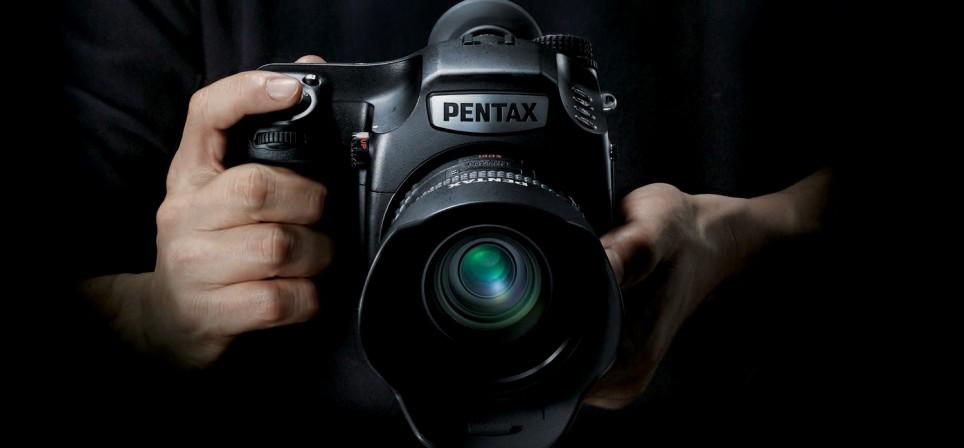 645Z_camera-in-hand-964x448