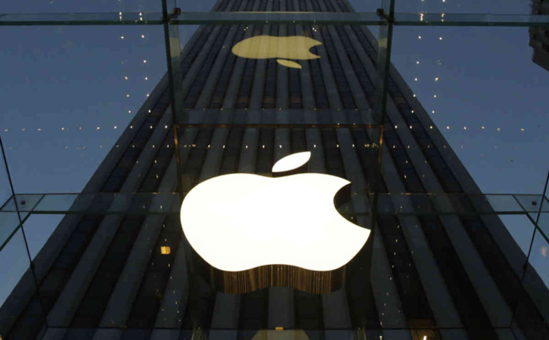 The Apple logo is illuminated in the entrance to the Fifth Avenue Apple store, Wednesday, Nov. 20, 2013 in New York. (AP Photo/Mark Lennihan)